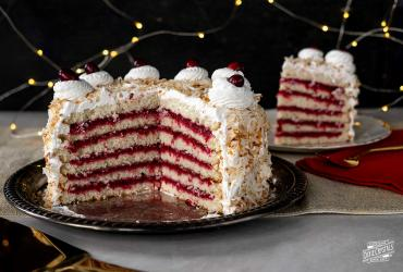 6 Layer Coconut Cranberry Cake with Meringue Frosting