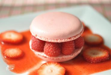 Raspberry Macarons with Chocolate Ganache and Strawberry Sauce