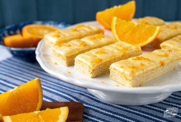 Sugar Cookie Bars with Orange Cream Cheese Frosting